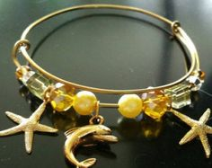 Beaded bracelet, charm bracelet,memory bracelet,bangle bracelet,adjustable bracelet, bead,charm,starfish,dolphin,gold,yellow by doubledzbeadz. Explore more products on http://doubledzbeadz.etsy.com