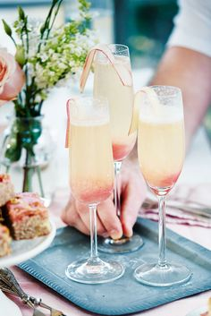 This refreshing, fun tipple is based on a classic bellini, but swaps in fresh rhubarb purée instead of peach. Simple, sweet, tangy and beautifully bubbly, it's the perfect cocktail to enjoy on Mother's Day. | Tesco