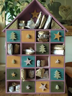 Decorated this little wooden house and transformed it into this beautiful advent calendar. I used chalk paint and wax. Diy Advent Calendar, Calendar Ideas, Advent House, Wooden House, Chalk Paint, Dodge, Diy Ideas, Christmas Crafts, Wax