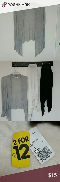 3 knit cardigans Thin and super lightweight.  Three colors: gray, white and black. Gray has 2 tinys holes that are barley seen, one pictured near pocket and other on wrist of sleeve. Black has never been worn and still has tags. These are perfect for fall layering! Forever 21 Sweaters Cardigans