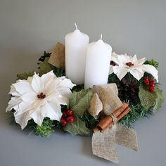 Christmas table centre using artificial greenery and crepe paper flowers. Made by The Flower and Craft Boutique