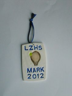 This polymer clay LZHS Tennis ornament has been made for my son, that plays on the tennis team. Please let me know what color clay you would ike your ornament's clay to be made in as well as what color paint you would like your name, school and year painted in. The ornament can be made in 2 colors of clay (your school colors). This particular polymer clay ornament was only made with one of the two colors of clay.