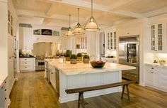 great kitchen layout, beautiful coffered ceiling, and interesting long bench instead of bar stools