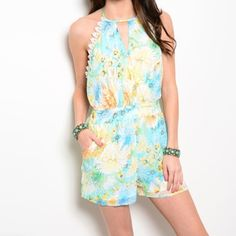 Low back tropical romper Beautiful and bright floral print romper featuring tie halter neck, pretty lace trim, and hidden back zipper. Fits true to size. 100% polyester. Available in small, medium, and large Pants Jumpsuits & Rompers