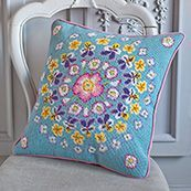 Pressed Flowers  A slightly different style from Kaffe Fassett, but stunning all the same. This needlepoint kit features some beautiful pink, yellow and blue flowers.