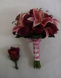 This is almost exactly what I want, but with the cream roses with pink tips and the wrapping in blue.