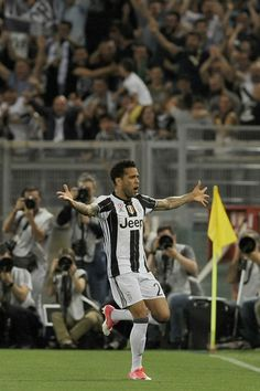 Daniel Alves Da Silva of FC Jucentus celebrates a opening goal during the TIM Cup Final match between SS Lazio and Juventus FC at Olimpico Stadium on May 17, 2017 in Rome, Italy.