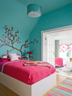 love the saturated colors and tree design on the wall