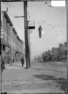 "A man named Frank Curry was hired by industry to bring ""scab"" labor into Chicago to break strikes. In this image, an effigy of Frank Curry has been hung over over 42nd Street and Wentworth Avenue during the Chicago City Railway Strike, November 19, 1903.  Photo credit: Chicago Daily News collection / Chicago History Museum / Getty Images"