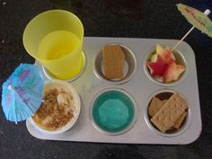 Since we spent last week at the beach, this week's Muffin Tin Meal has a beach theme! Despite the cute cocktail umbrellas I found, this muffin tin meal didn't Muffin Tin Recipes, Cupcake Recipes, Snack Recipes, Snacks, Muffin Tins, Toddler Meals, Kids Meals, Summer Food Kids, Good Food