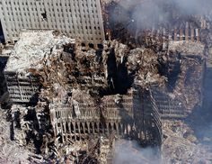 An aerial view on September 17th, 2001 shows only a small portion of the scene where the World Trade Center collapsed following the Sept. 11 terrorist attack. Surrounding buildings were heavily damaged by the debris and massive force of the falling twin towers. (U.S. Navy photo by Chief Photographer's Mate Eric J. Tilford)