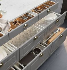 Why You Should Choose Drawers Instead of Cabinets in Your Kitchen   The typical American kitchen has lower cabinets with doors. This is one of the worst ideas because there isn't as much room for storage and organization. Using drawers gives you so many more options using bins and more for organizing plates, bowls, silverware, glasses, cookware, and more.