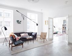 Beach house inspiration - large doors, lighting, blonde wooden floor. Think herringbone for the library/reading room only?