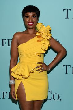 Jennifer Hudson dazzled in a yellow DSquared dress and Tiffany diamond pave cuff and solitaire diamond earrings in a fashion red carpet and jewellery statement at the Tiffany & Co. Blue Book 2017 Gala. http://www.thejewelleryeditor.com/brands/tiffany-co/ #jewelry