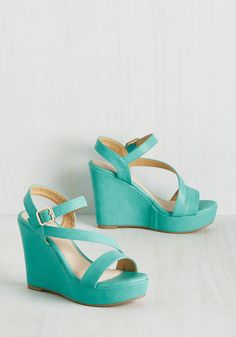 Reminisced Opportunity Wedge in Seaglass. Reflecting on your favorite fashion achievements, you realize these platform wedges were worn in every scenario! #green #wedding #modcloth