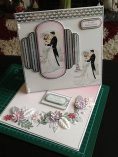 A Twisted easel card made with 8 x 8 card. This is done in the Art Deco era. Flowers from Wild Orchid
