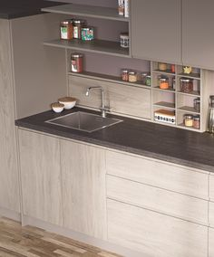 EGGER Kitchen  Worktop F293 ST82 Tivoli Anthracite: A modern stone design, Tivoli Anthracite is a calmer version of natural limestone. Appearing as though it has many small perforations on the surface, it is a highly authentic decor that combines with a broad range of solid colours and woodgrains, in particular those that feature white.  Doors: H3760 ST29 White Cape Elm and U708 ST15 Light Grey