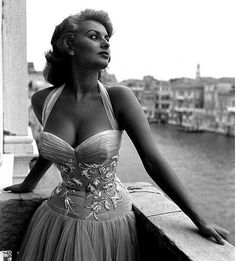 Italian superstar Sophia Loren portayed standing on a terrace on the Canal Grande, wearing a white embroidered dress, Venice, 1955