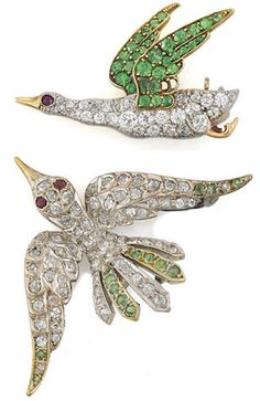 *Two antique demantoid garnet and diamond bird brooches both in-flight birds…