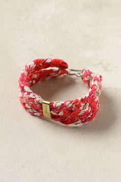 Braided fabric, a long strip, folded in half, secured with metal strips.... yeah, I can make this too