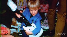 Little Kurt Cobain playing guitar ❤ Always a lefty! Gif image from 'Montage Of Heck' trailer.