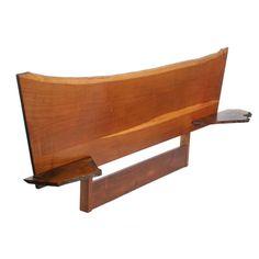 English brown oak headboard with cantilevered walnut shelves, George Nakashima.