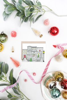 Classic brownstones are showing off their holiday spirit with holly bushes at their doorsteps and wreaths with red ribbon on their doors. // Holiday Brownstone Scene - A2 Note Card