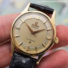 Brilliant! A 1960 vintage Omega Constellation Ref. 14381/2-SC with a 14K yellow gold case, a patinated, silver dial with applied, yellow gold-colored bar markers and a recessed, minute track. This fine example also comes strapped with a 24-jewel,... #omeg