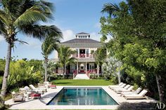 Chinese Chippendale–style railings and a 40-foot-long pool distinguish the Bahamian retreat, named Highlowe, that the designer shares with her husband, Steve Uihlein.