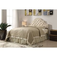Traditional grandeur is yours when you add this beautiful upholstered headboard to your master bedroom suite for the ideal addition. Choose from either a beige or charcoal polyester fabric to find the design perfect for your style. Button tufting, nail head trim, and scooped arched create the stunning silhouette you have been looking for.