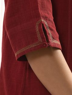 Buy Maroon SURKH Handloom Cotton Kurta with Embroidery Women Kurtas Rang Raas Add a splash of color to your wardrobe vibrant Kurti Sleeves Design, Sleeves Designs For Dresses, Neck Designs For Suits, Kurta Neck Design, Neckline Designs, Dress Neck Designs, Sleeve Designs, Blouse Designs, Simple Kurti Designs