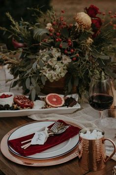 Loving this romantic table runner. Get this and more moody tablescapes that are beautiful for the holidays. #tablescapes #tabledecor #holidaytable #tabledecorations #holidaydecor
