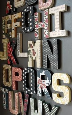 Buy wooden letters at Hobby Lobby or your local craft supply store and glue scrapbook paper to them. Mount them on the wall! The more uncoordinated the scrapbook paper is, the better it looks. The contrasts of all the different patterns put together look gorgeous.