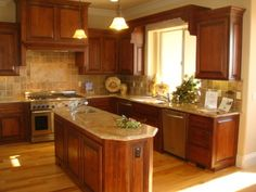 Hickory Floors with Cherry Cabinets.  Photo shows light counters with hickory floor.
