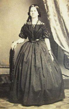 Woman in formal attire, wearing a Sheer fichu (shawl). 1860's civil war era fashion