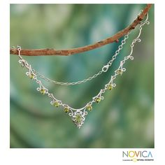 Designed by Neeru Goel, this handcrafted necklace showcases peridot in sterling silver. She creates an elegant necklace with cutout motifs that exemplify India's legendary 'jali' technique.