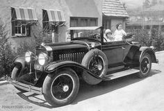 Susan Earl, Harley J. Earl's wife their first born son, Billy in her LaSalle Convertible Coupe