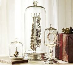Glass Cloche Jewelry Storage | Pottery Barn.  I've never seen these glass forms used in this manner.  Quite a unique way to display jewelry.