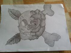 Half skull, half rose.