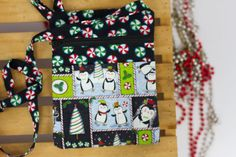 These cute, playful penguins bring a festive feeling to any outing. Great for keeping your hands free during the busy shopping season. Wouldnt black Friday shopping be convenient and less stressful if you didnt have to worry about keeping your bulky, heavy purse in sight? This little cross body purse will bring you Christmas joy throughout the holiday season. The purchase of this listing is for one Christmas Penguins Cross body Bag with the following specifications: Measurements: 9 x 7…