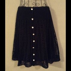 BETSEY JOHNSON Crochet Mini Absolutely adorable BETSEY crocheted mini with lining. Jewel buttons. Like new. Betsey Johnson Skirts Mini