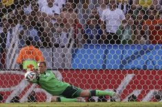 Germany's goalkeeper Manuel Neuer makes a save on a shot on goal by Ghana's Christian Atsu during the group G World Cup soccer match between Germany and Ghana at the Arena Castelao in Fortaleza, Brazil, Saturday, June 21, 2014