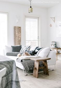 White sofa / Scandinavian interior / living room / fairy lights