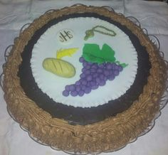 Torta prima comunione base pan di Spagna al cioccolato crema al cioccolato e copertura con ganache al cioccolato