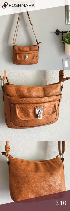 Rosetti Lana Cognac Crossbody Purse Rosetti Lana Cognac Crossbody Purse.                               Cute little cognac crossbody bag by Rosetti. Moderately used. Shows some signs of wear (minor scuffs on front, hard to pick up on camera but pictured in the close up) but still in good used condition. Dimensions & other specifics shown in pictures. Rosetti Bags Crossbody Bags