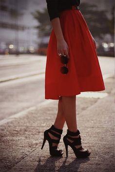 orange skirt, black shoes