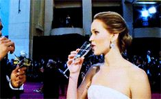 When she downed this champagne like a champ and everyone behind her was in awe: | 51 Times In 2013 Jennifer Lawrence Proved She Was Master Of The Universe