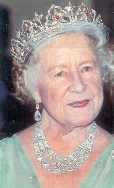 The Queen Mother wearing the Oriental Circlet Tiara. The tiara was made for Queen Victoria in 1853.  The inspiration for the design of this tiara, which includes 'Moghul' arches framing lotus flowers, came from Prince Albert who had been greatly impressed by the Indian jewels presented to the Queen by the East India Company at the conclusion of the Great Exhibition.