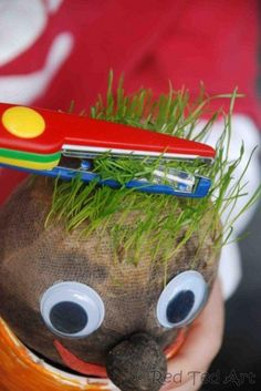 DIY grass head using stockings, seeds, soil, and a pot
