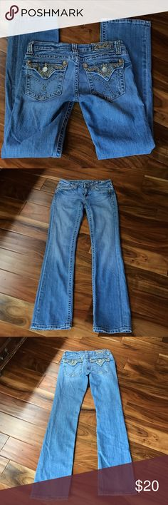 """Miss Me Modelo embroidered pocket boot cut jeans Tags for size fabric in care or posted. Color is a light wash. Slight wear to leg cuffs. Zipper works. Button-down back pockets with beige and brown stitching and embellishments. Logo on the back is embroidered. Small distress mark on back pocket. Flat waist measures 15 1/2"""". Rise is about 7 inches.  Inseam 32"""". No trades. #4 Miss Me Jeans Boot Cut"""